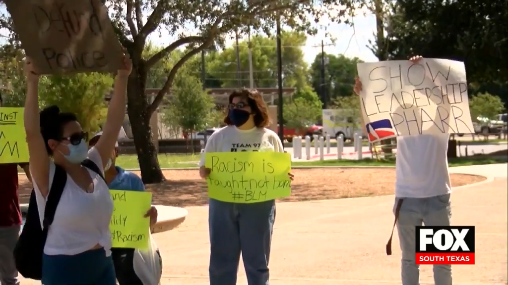 Protesters Call For Commissioner's Resignation